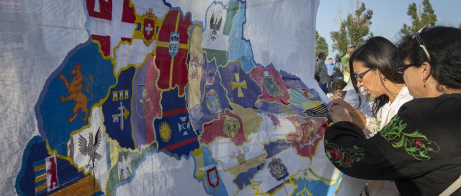Ukrainian women embroider a map of Ukraine with the different flags of the regions in the country during a pro-Ukranian meeting in the southern coastal town of Mariupol September 13, 2014. VASILY FEDOSENKO/REUTERS